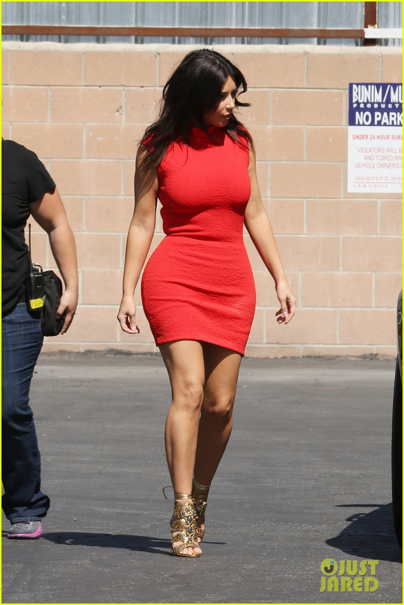 kim kardashian shows her figure in a tight little red dress 073072028