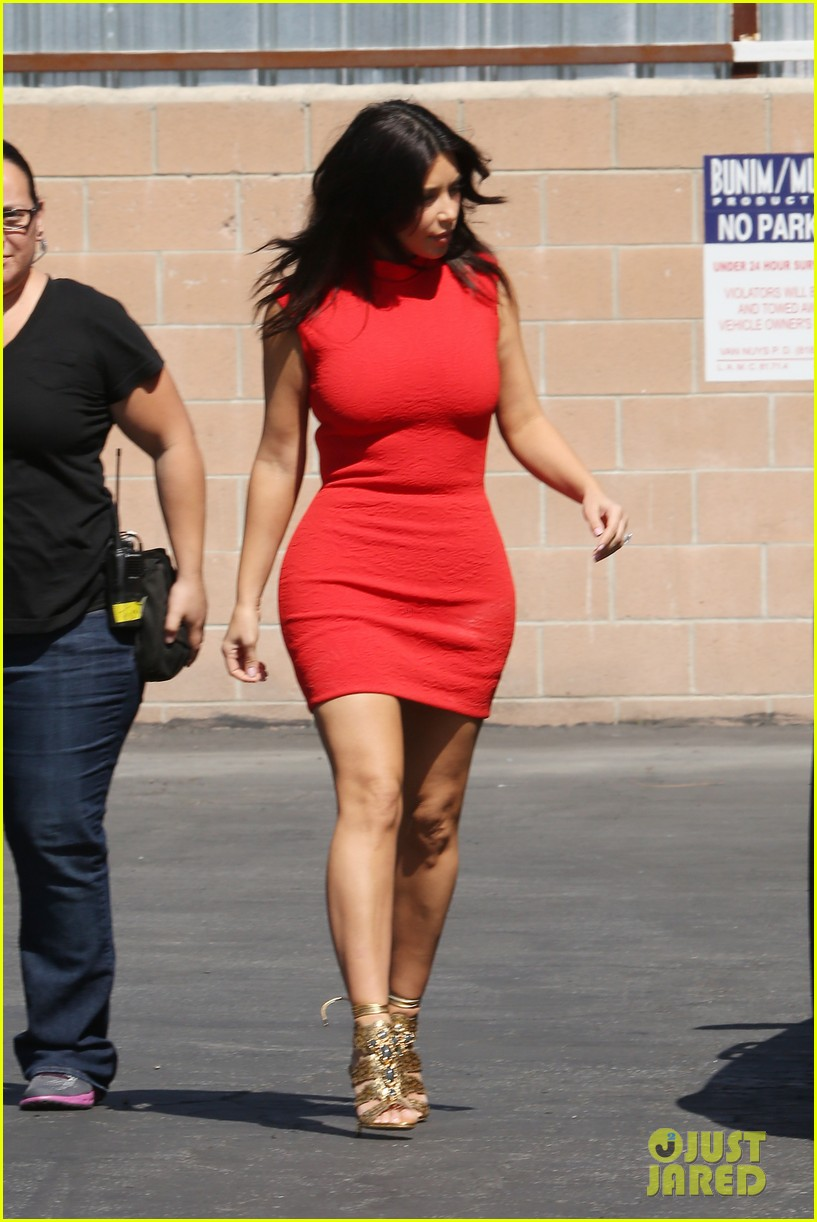 kim kardashian shows her figure in a tight little red dress 083072029