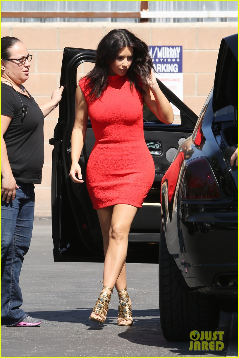 kim kardashian shows her figure in a tight little red dress 093072030