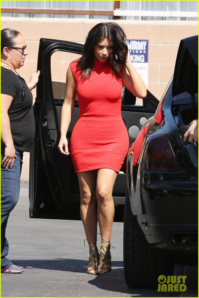 kim kardashian shows her figure in a tight little red dress 10