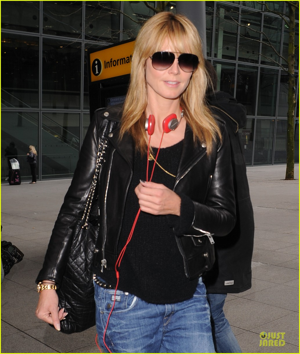 heidi klum stands out with red headphones 223070057