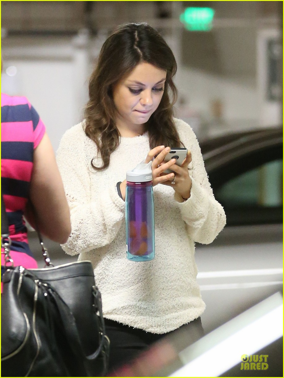 mila kunis brightens up the day with shopping 103072352