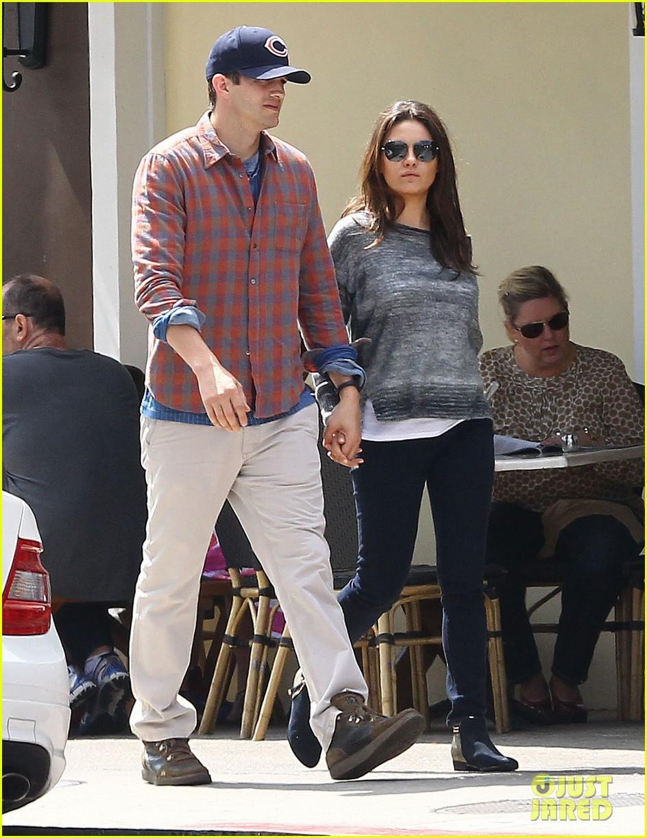 mila kunis ashton kutcher hold hands pregnancy rumors 013076721
