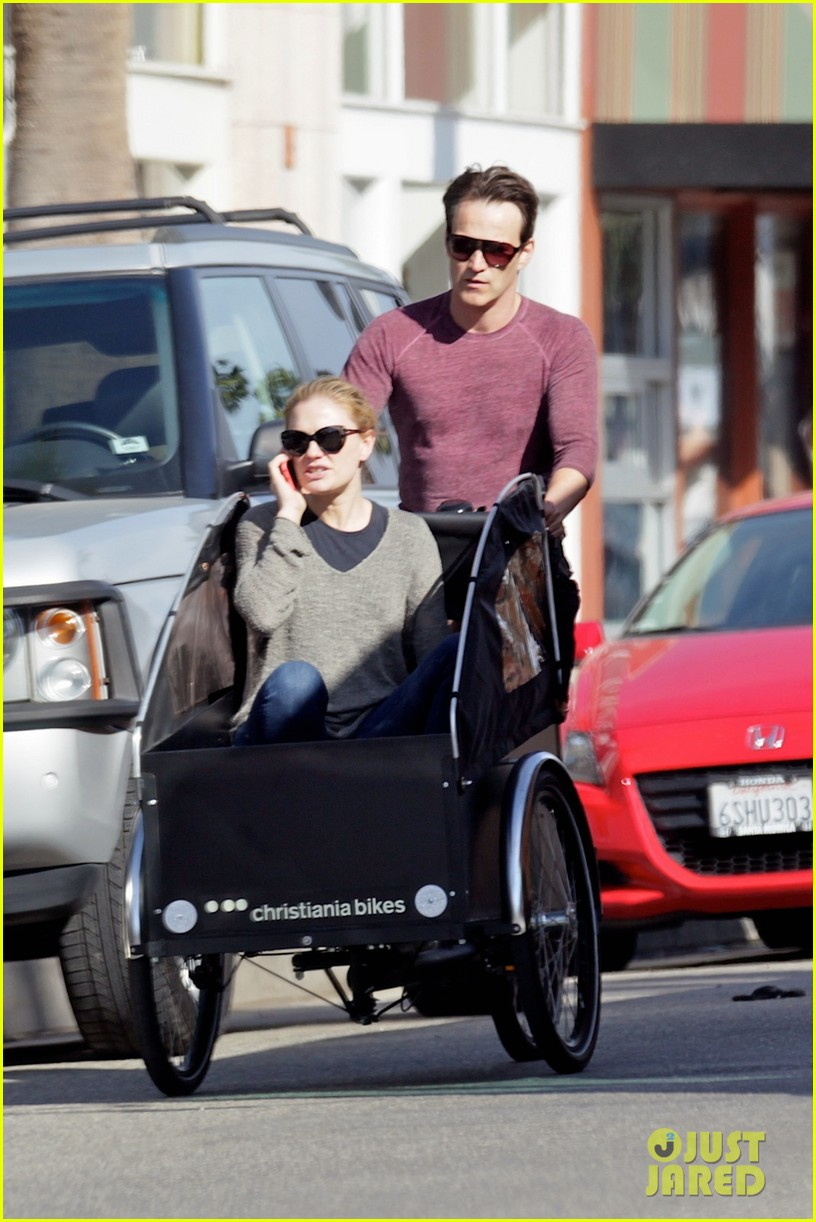 stephen moyer is quite the chauffeur peddles anna paquin in their twins bike carrier 033076096