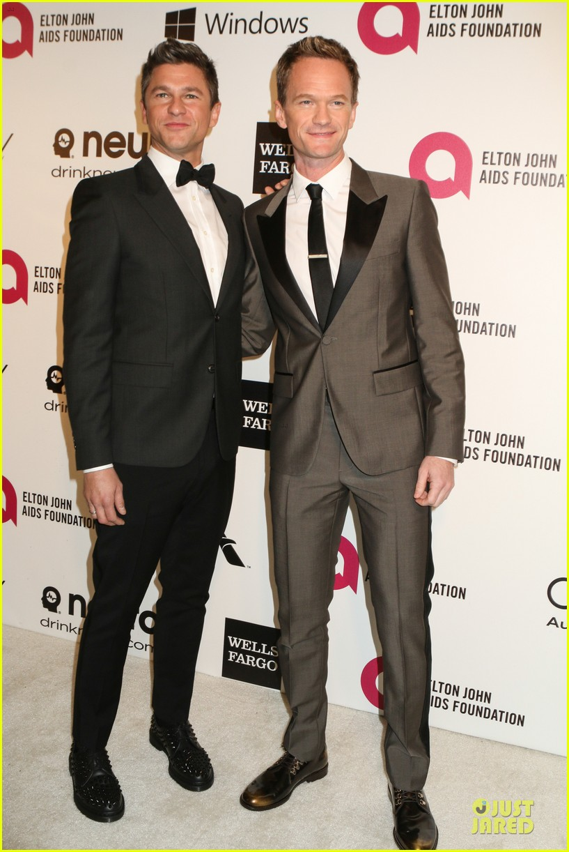 neil patrick harris david burtka are partners in crime at elton john oscars party 2014 05