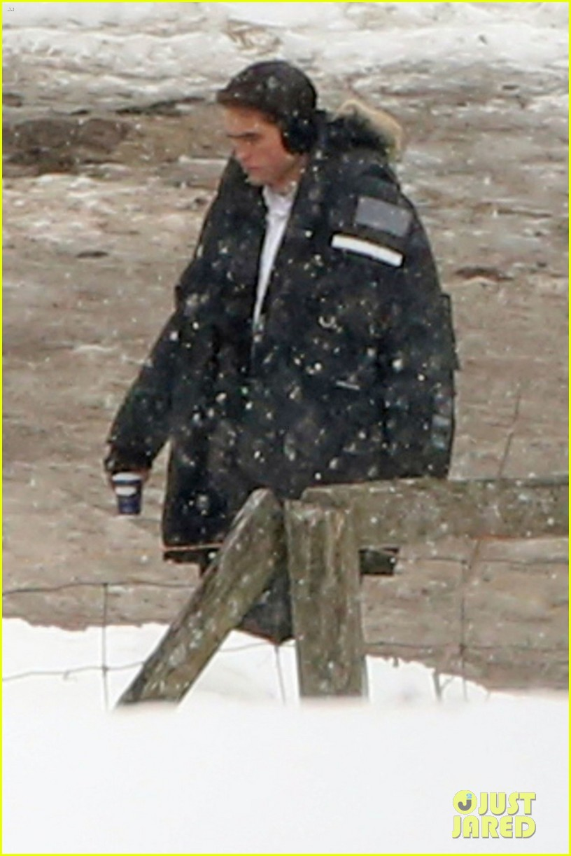 robert pattinson keeps warm with earmuffs on snowy life set 023063247