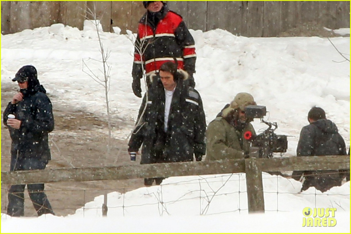 robert pattinson keeps warm with earmuffs on snowy life set 04