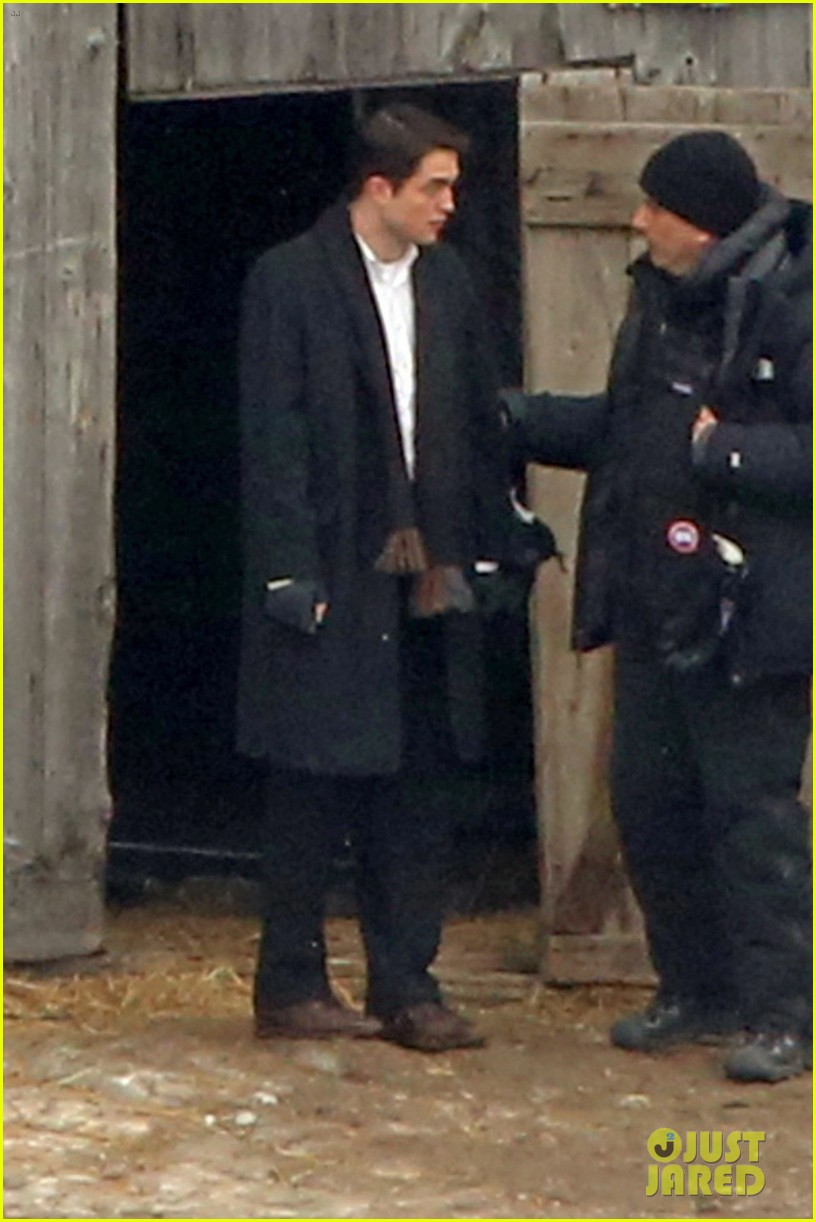 robert pattinson keeps warm with earmuffs on snowy life set 053063250