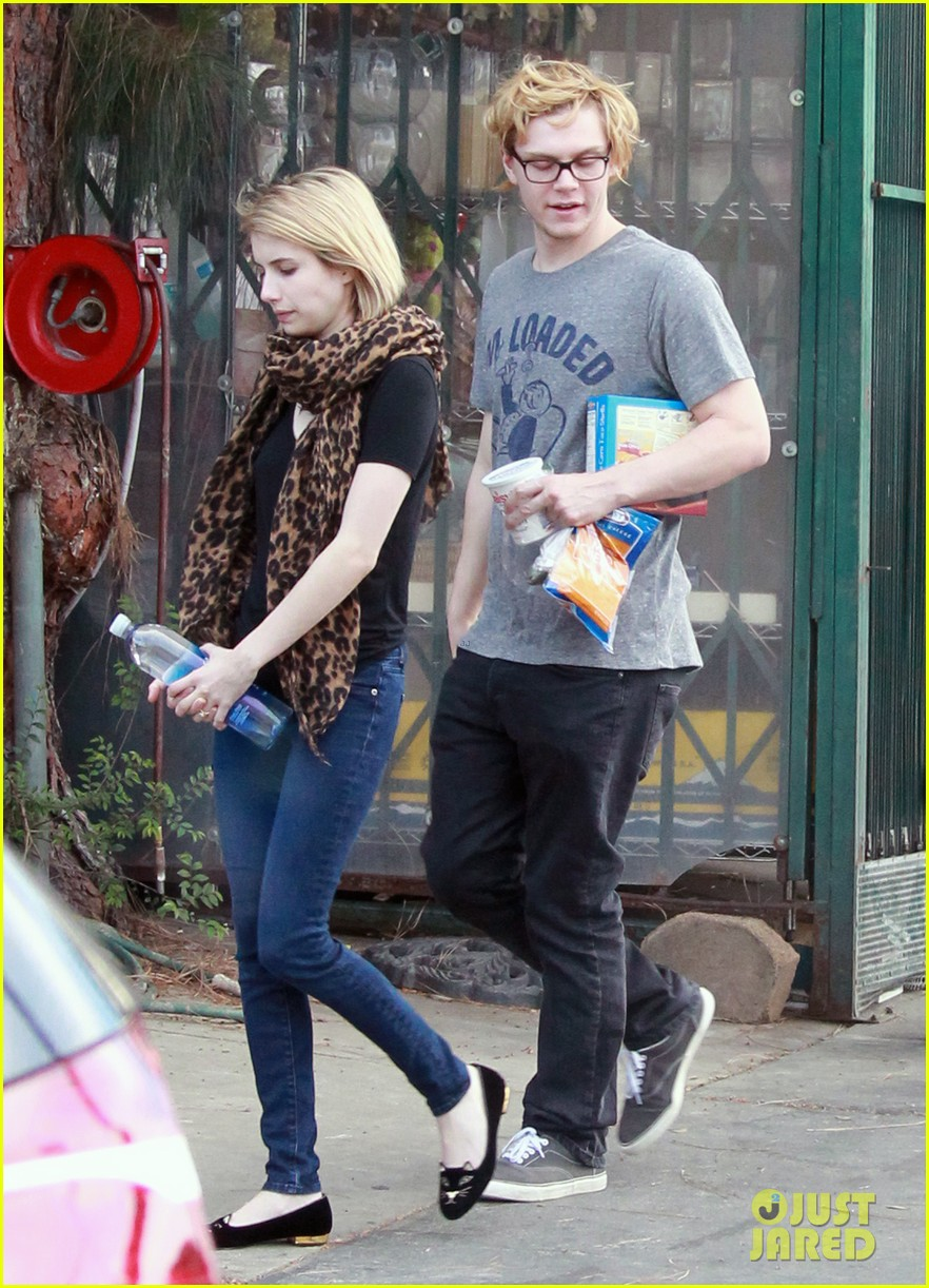 evan peters rests hand on emma roberts head 033069299