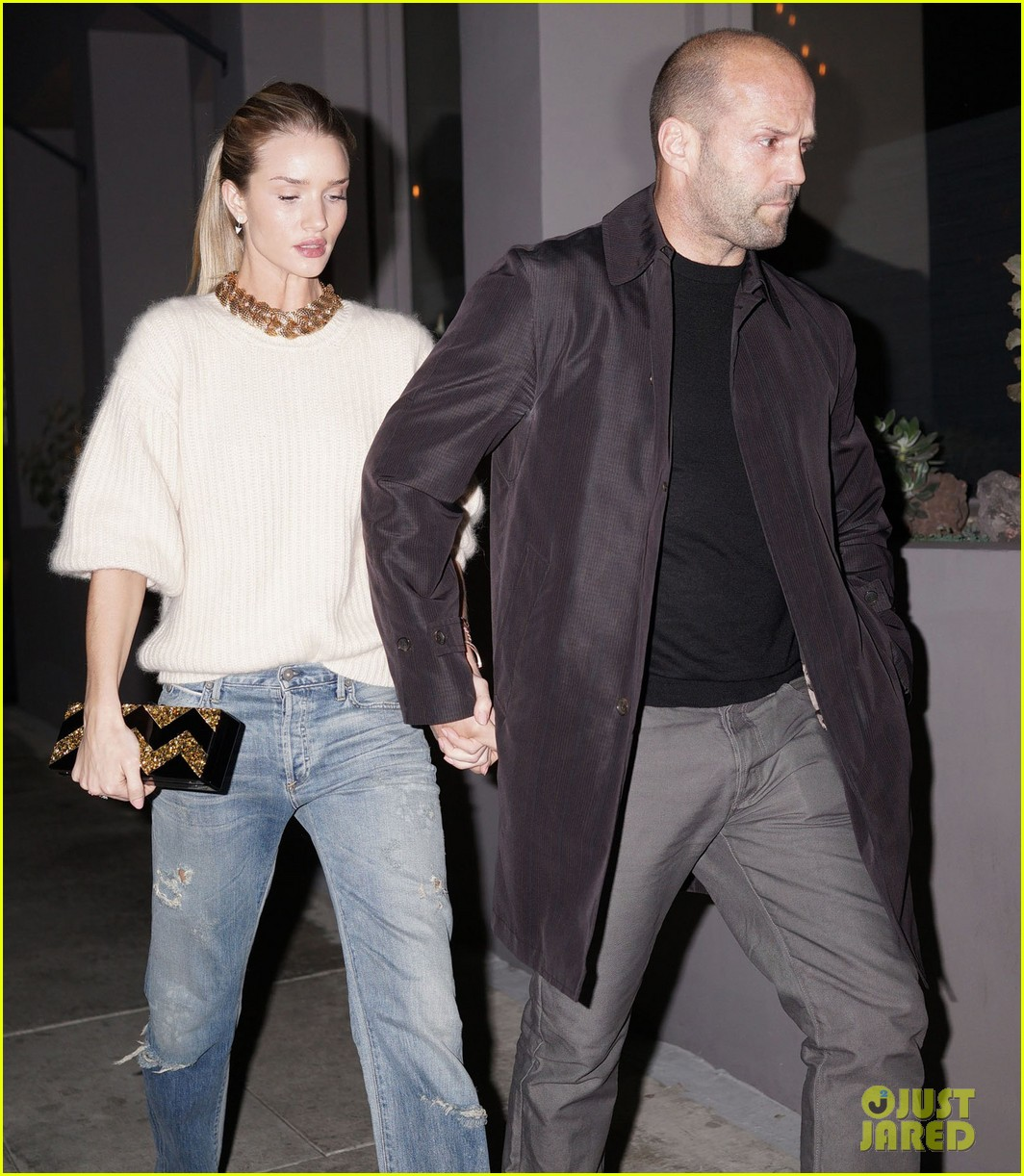 rosie huntington whiteley jason statham hold hands en route to dinner 063066607