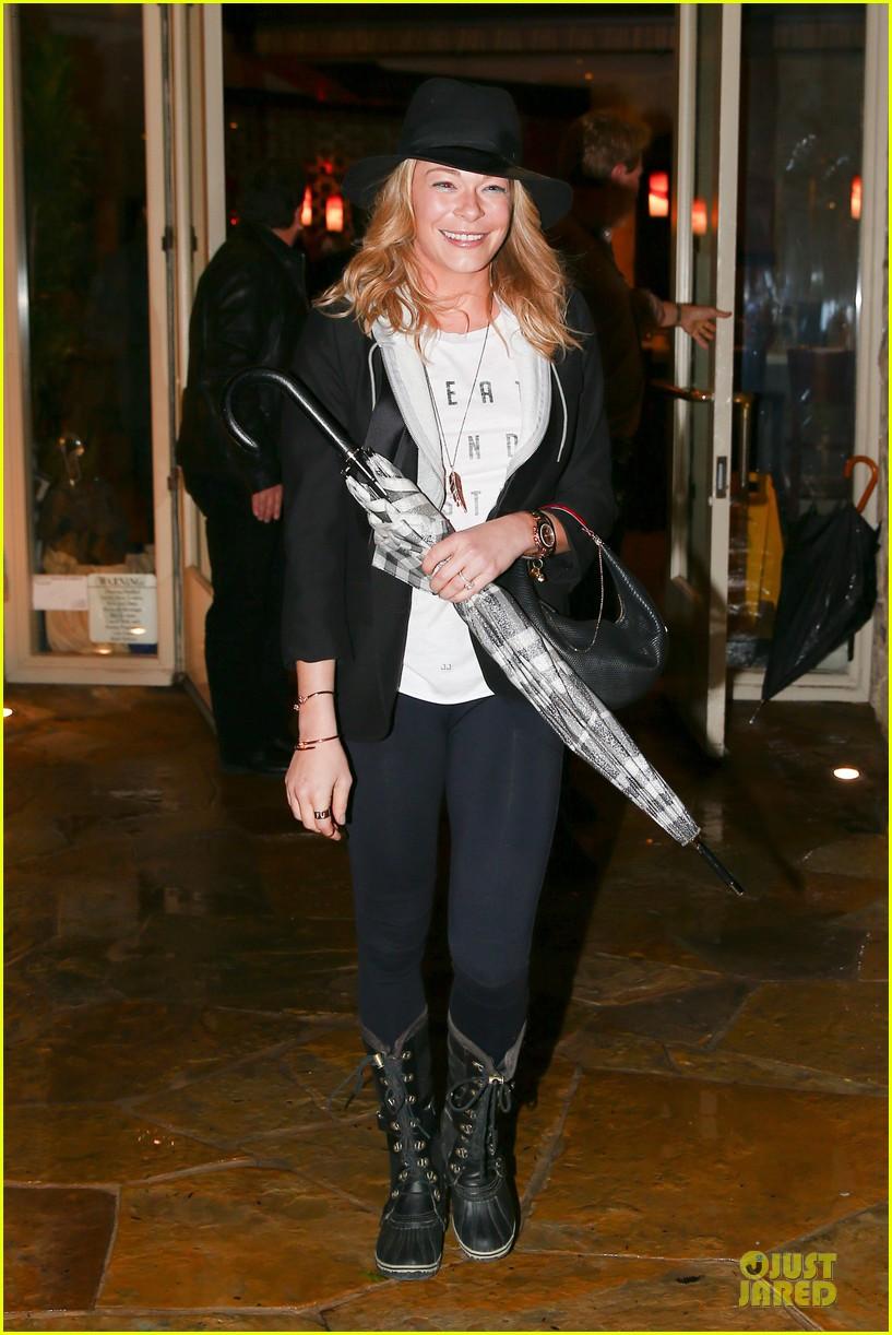 leann rimes fights rain storm with umbrella at tosconova restaurant 103062642