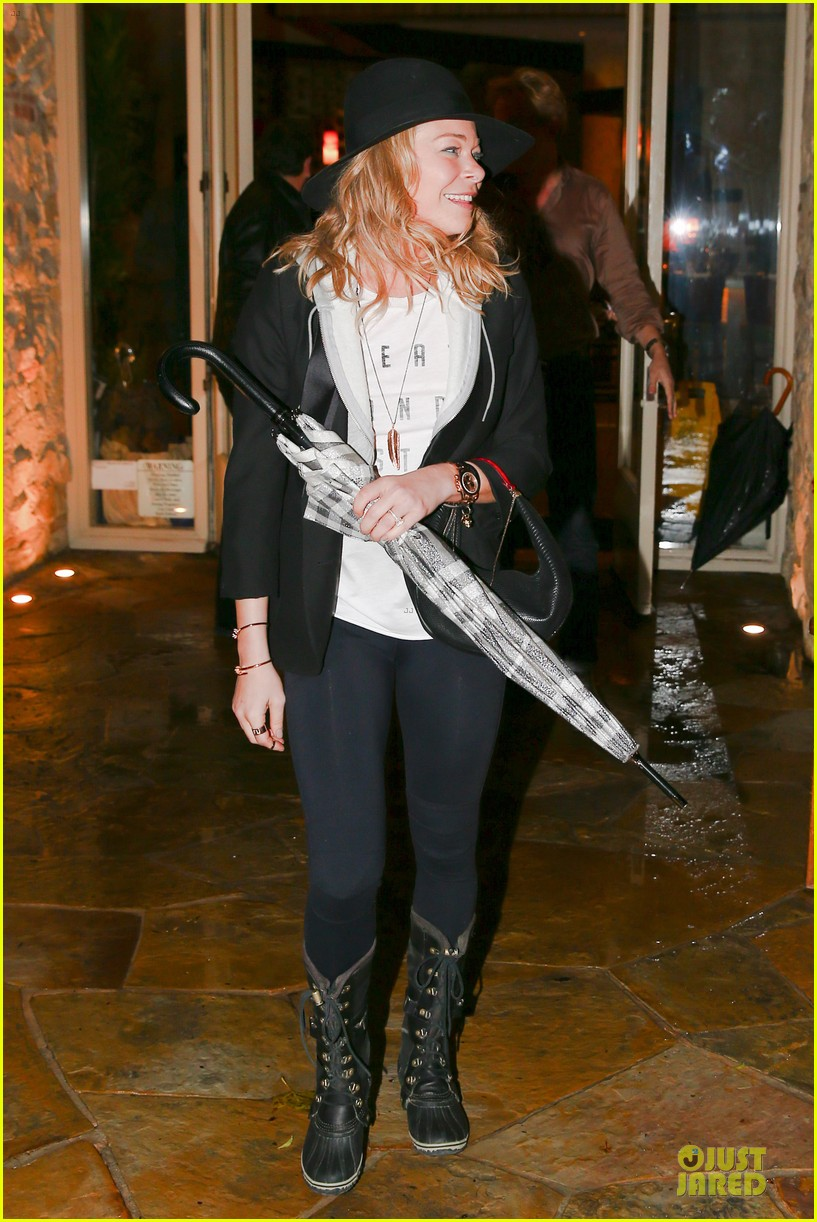 leann rimes fights rain storm with umbrella at tosconova restaurant 17