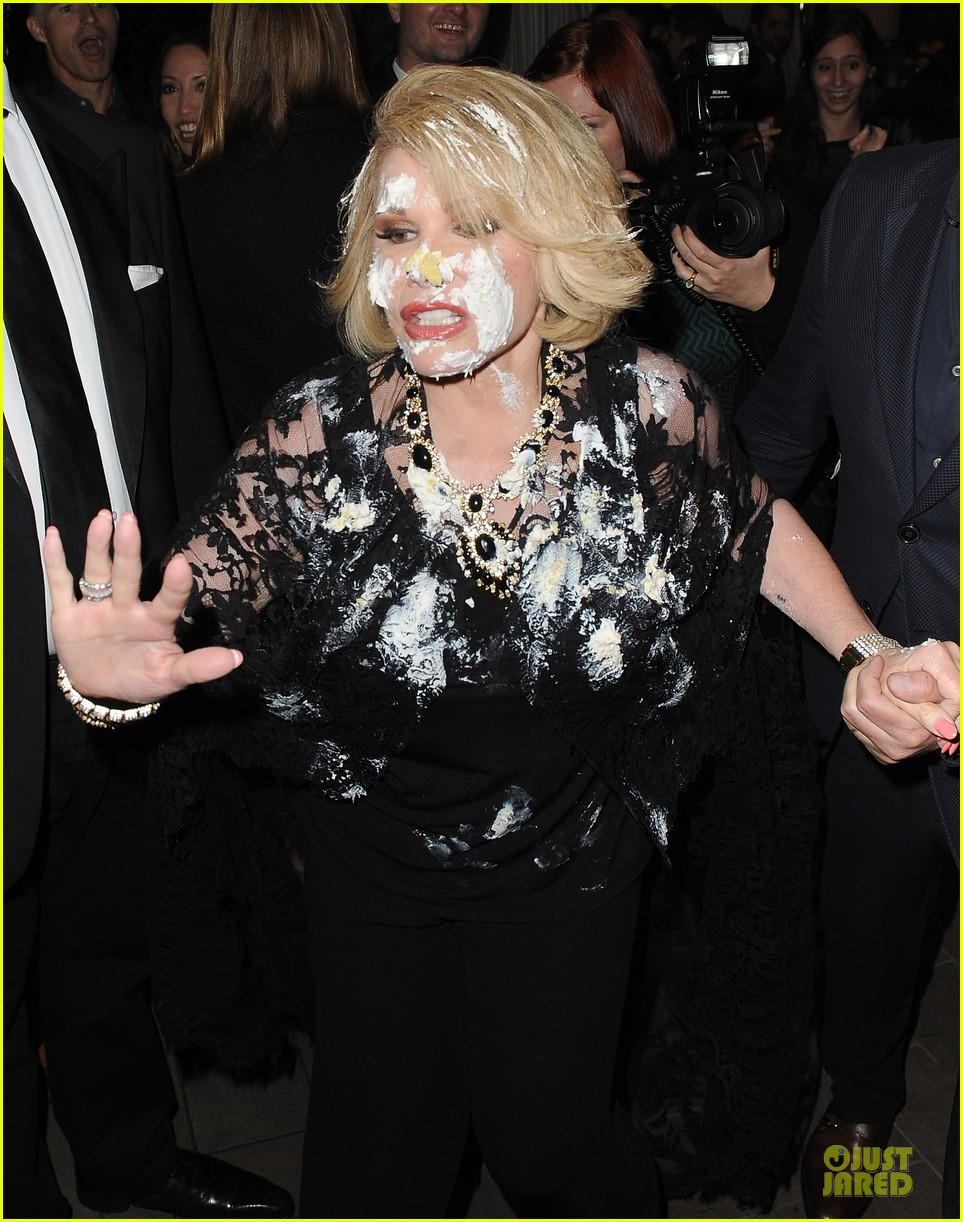 joan rivers gets attacked with cake at gvc red carpet event 023062656
