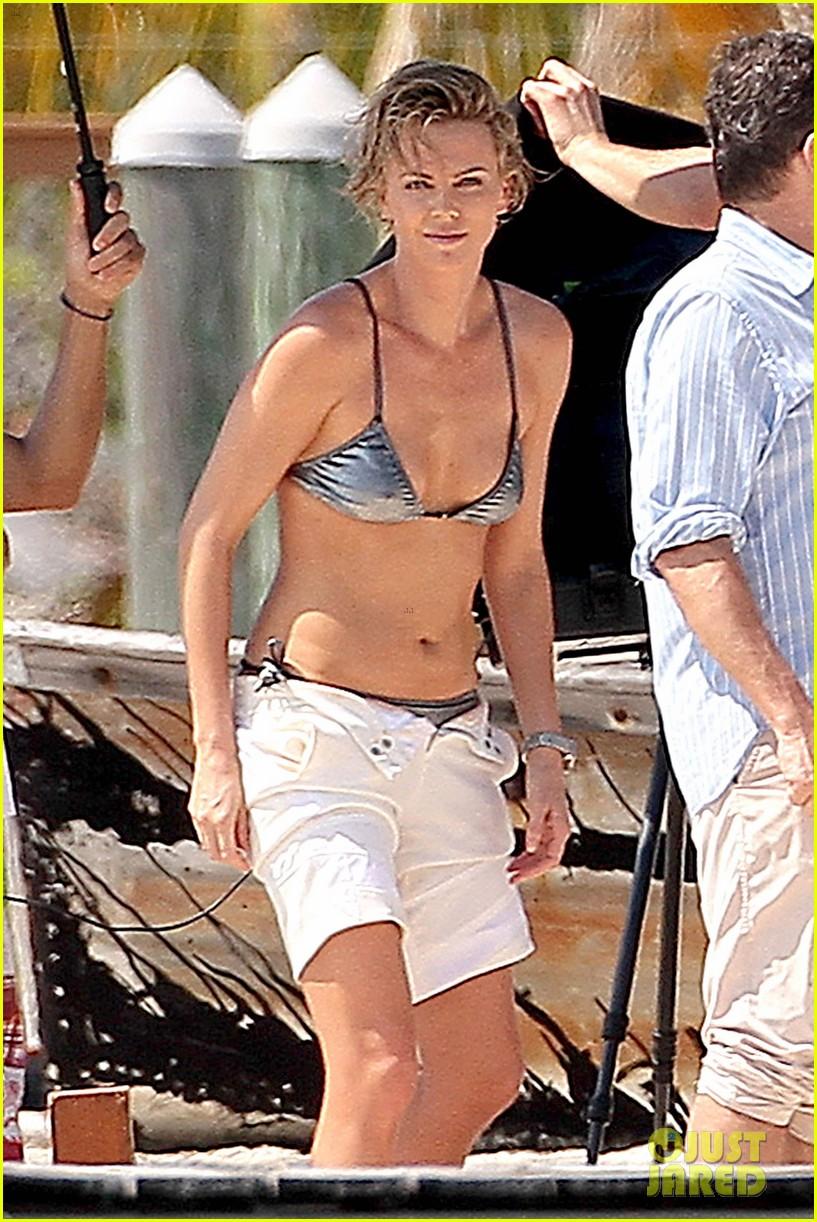 charlize theron bares her bikini body for miami photo shoot 02