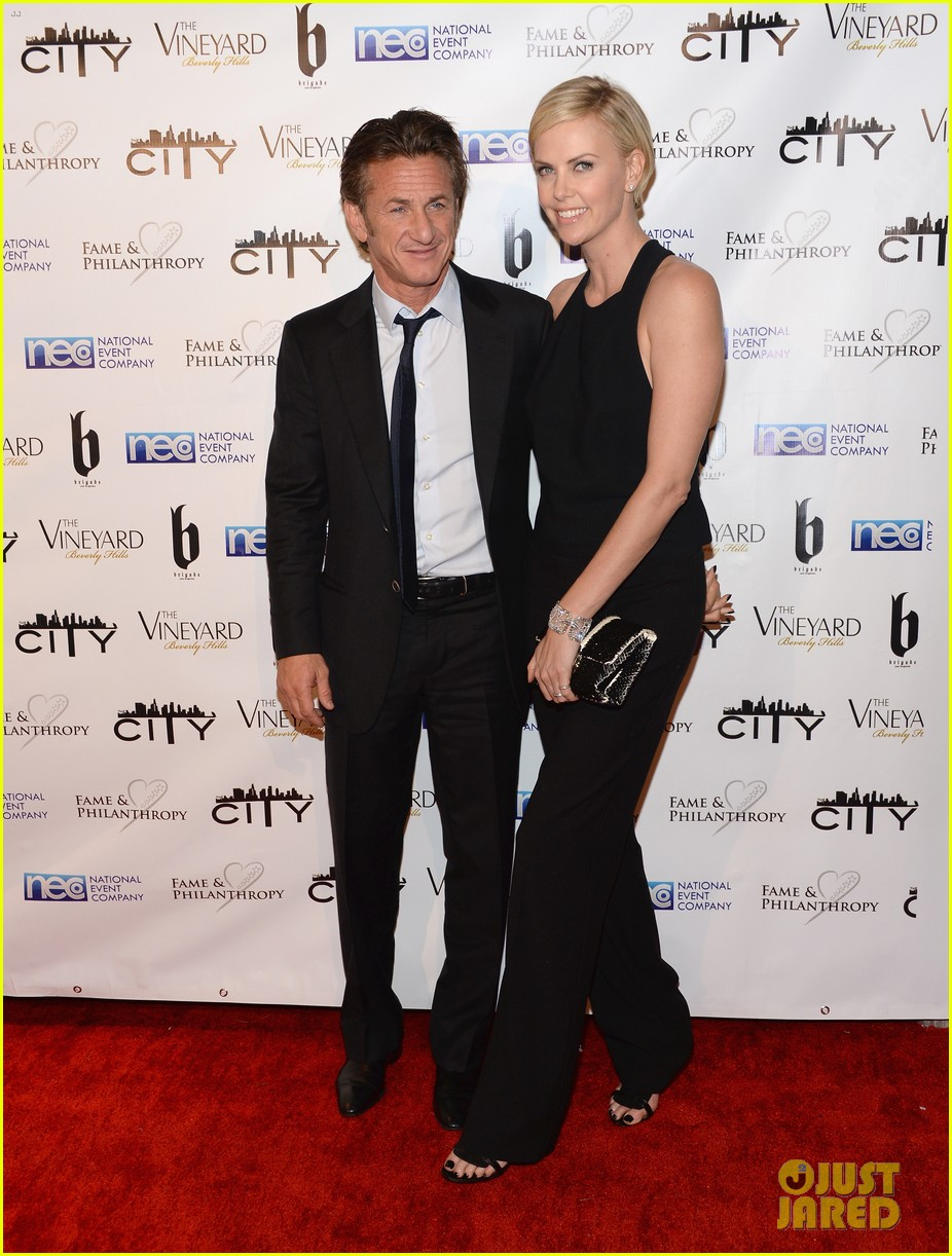 charlize theron sean penn walk first red carpet together at oscars 2014 party 063064645