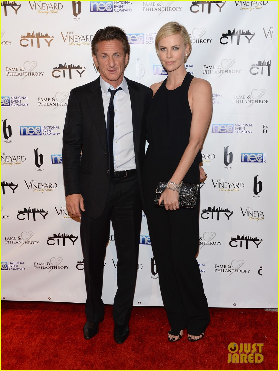 charlize theron sean penn walk first red carpet together at oscars 2014 party 093064648