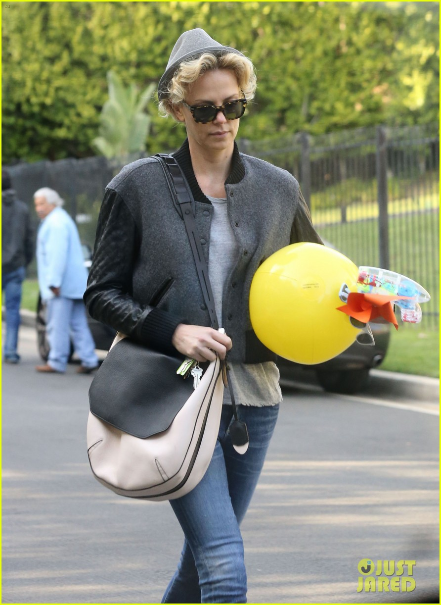 charlize theron attends party while 023076870