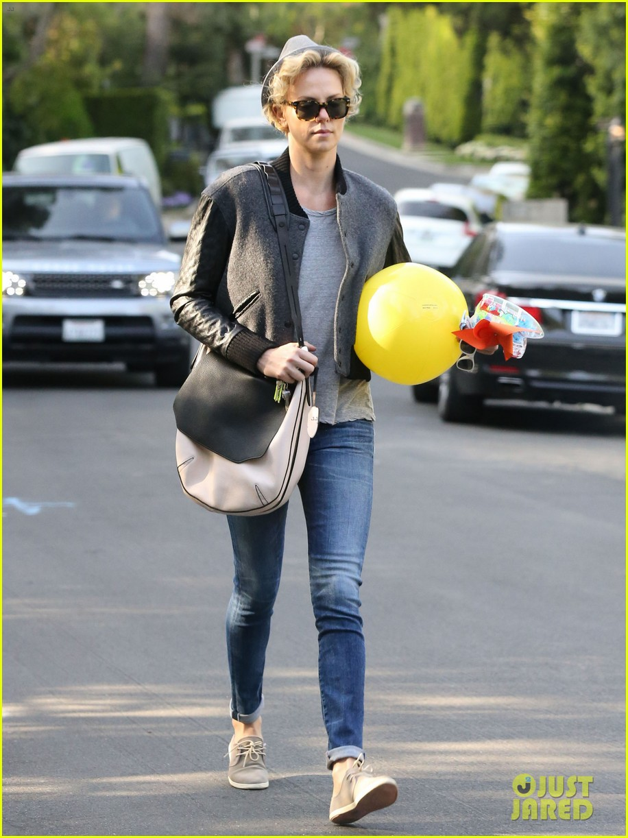 charlize theron attends party while 053076873