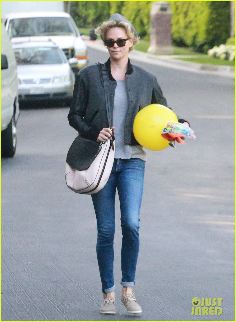 charlize theron attends party while 073076875