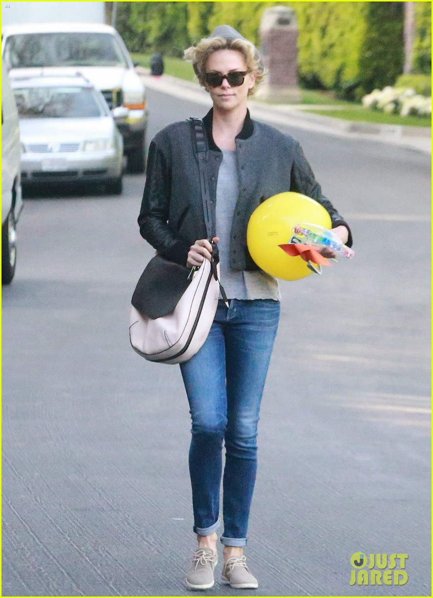charlize theron attends party while 083076876