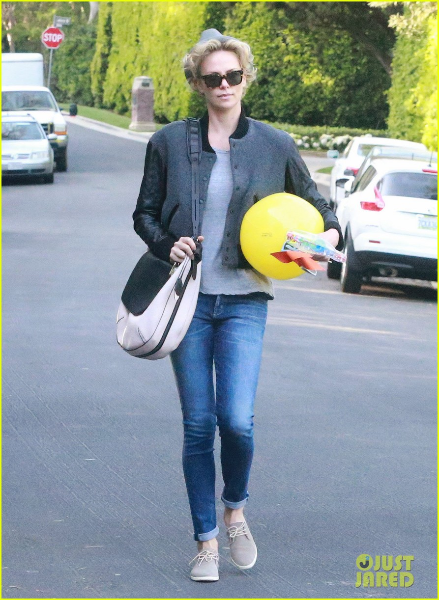 charlize theron attends party while 093076877