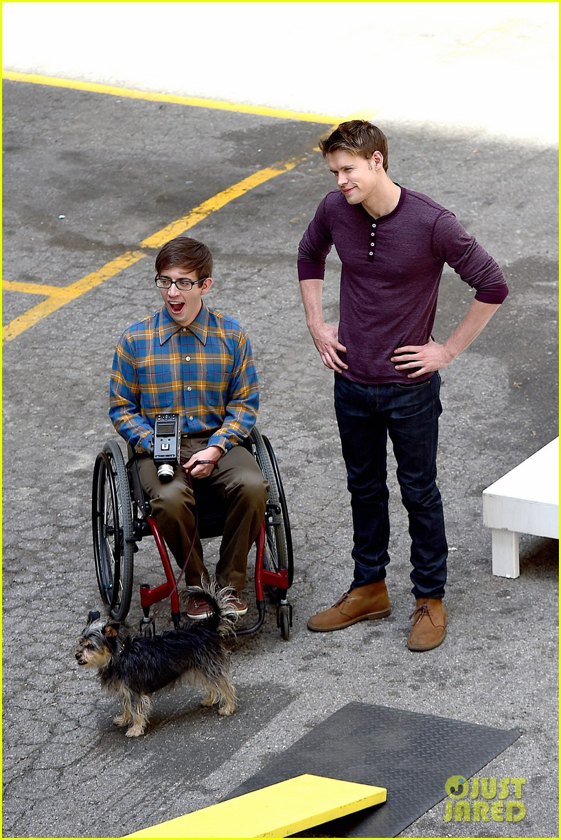 chord overstreet dotes on a dog its really cute 073098249