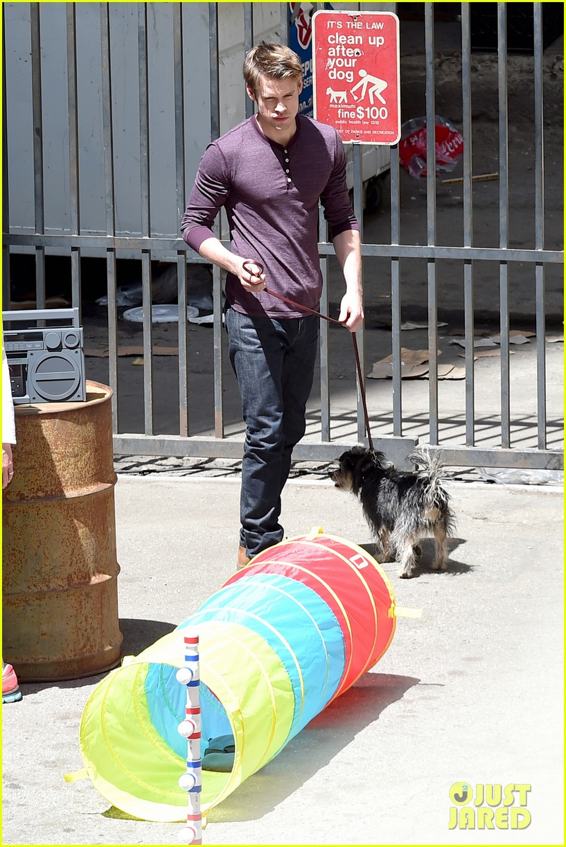 chord overstreet dotes on a dog its really cute 183098260
