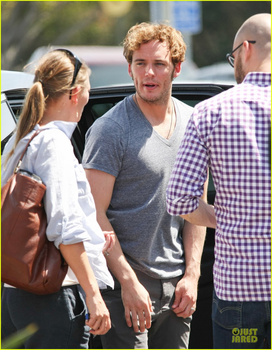 sam claflin very happy with extra gun show 163096427
