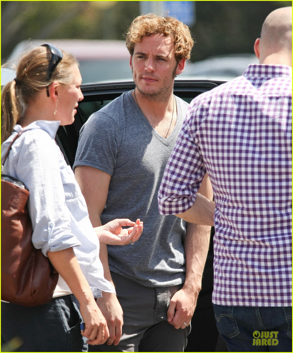 sam claflin very happy with extra gun show 203096431