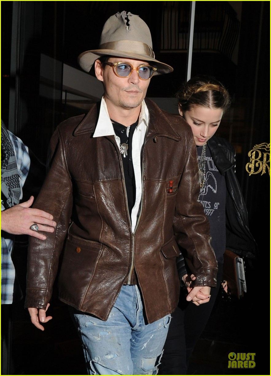 johnny depp amber heard surrounded by books 07