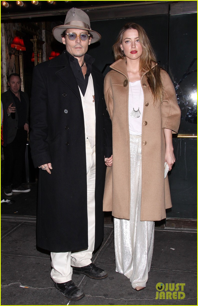 johnny depp amber heard hold hands at cabaret opening 013098558
