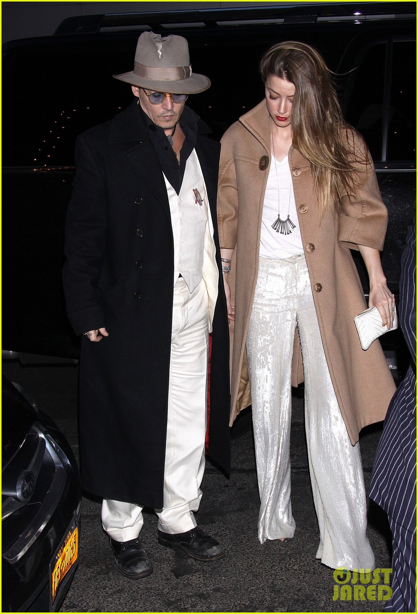 johnny depp amber heard hold hands at cabaret opening 093098566