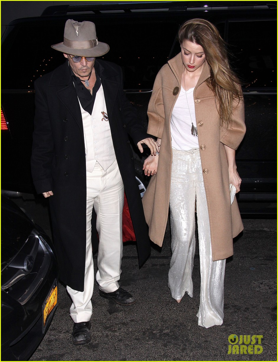 johnny depp amber heard hold hands at cabaret opening 103098567