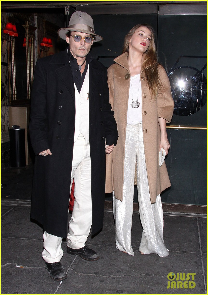 johnny depp amber heard hold hands at cabaret opening 143098571