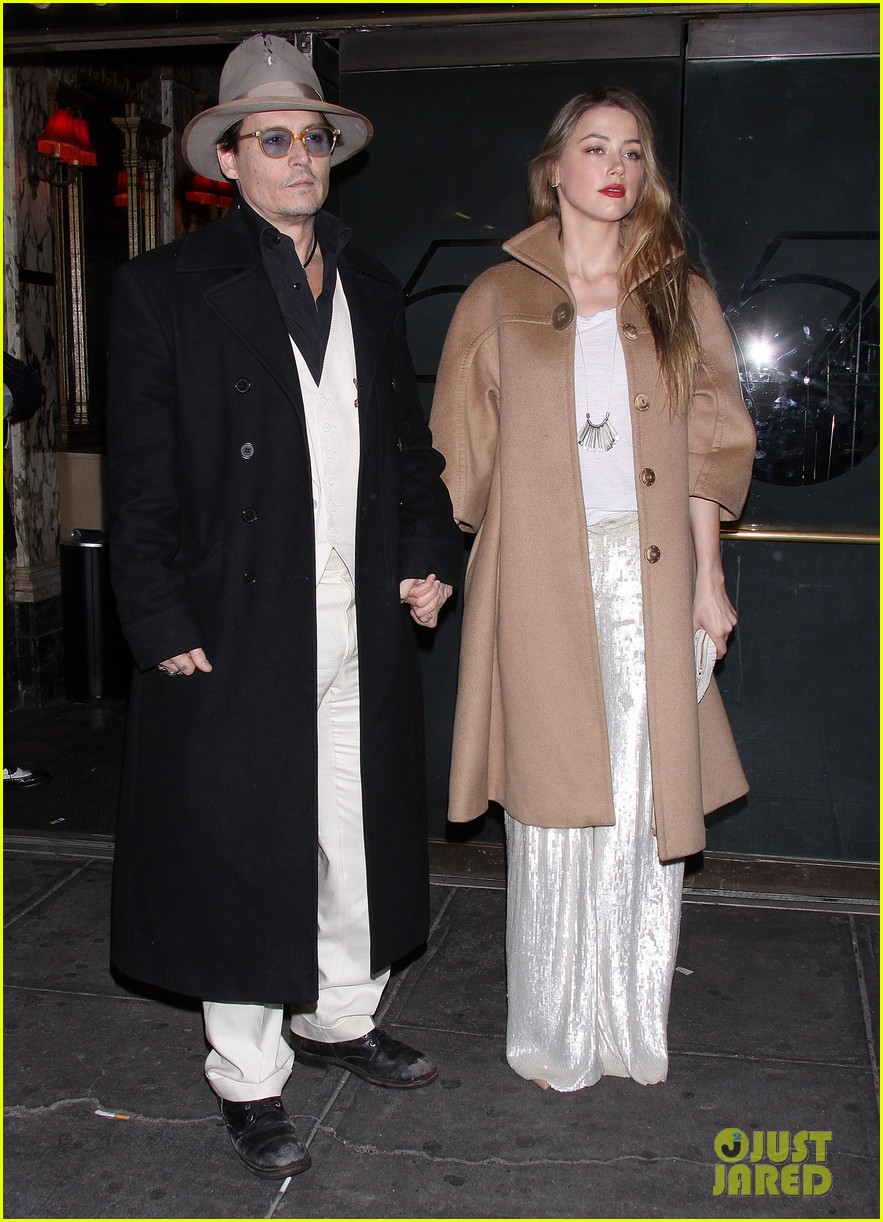 johnny depp amber heard hold hands at cabaret opening 153098572