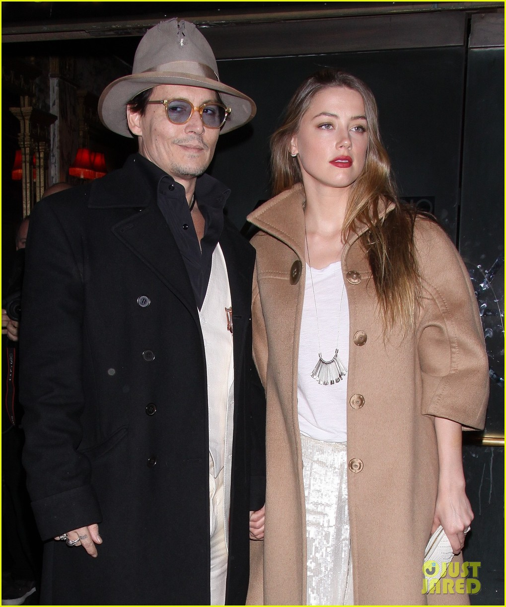 johnny depp amber heard hold hands at cabaret opening 183098575