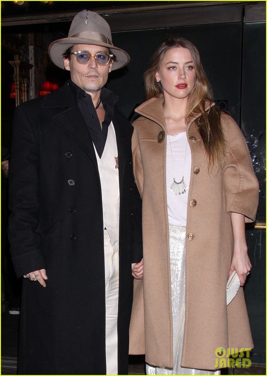 johnny depp amber heard hold hands at cabaret opening 19