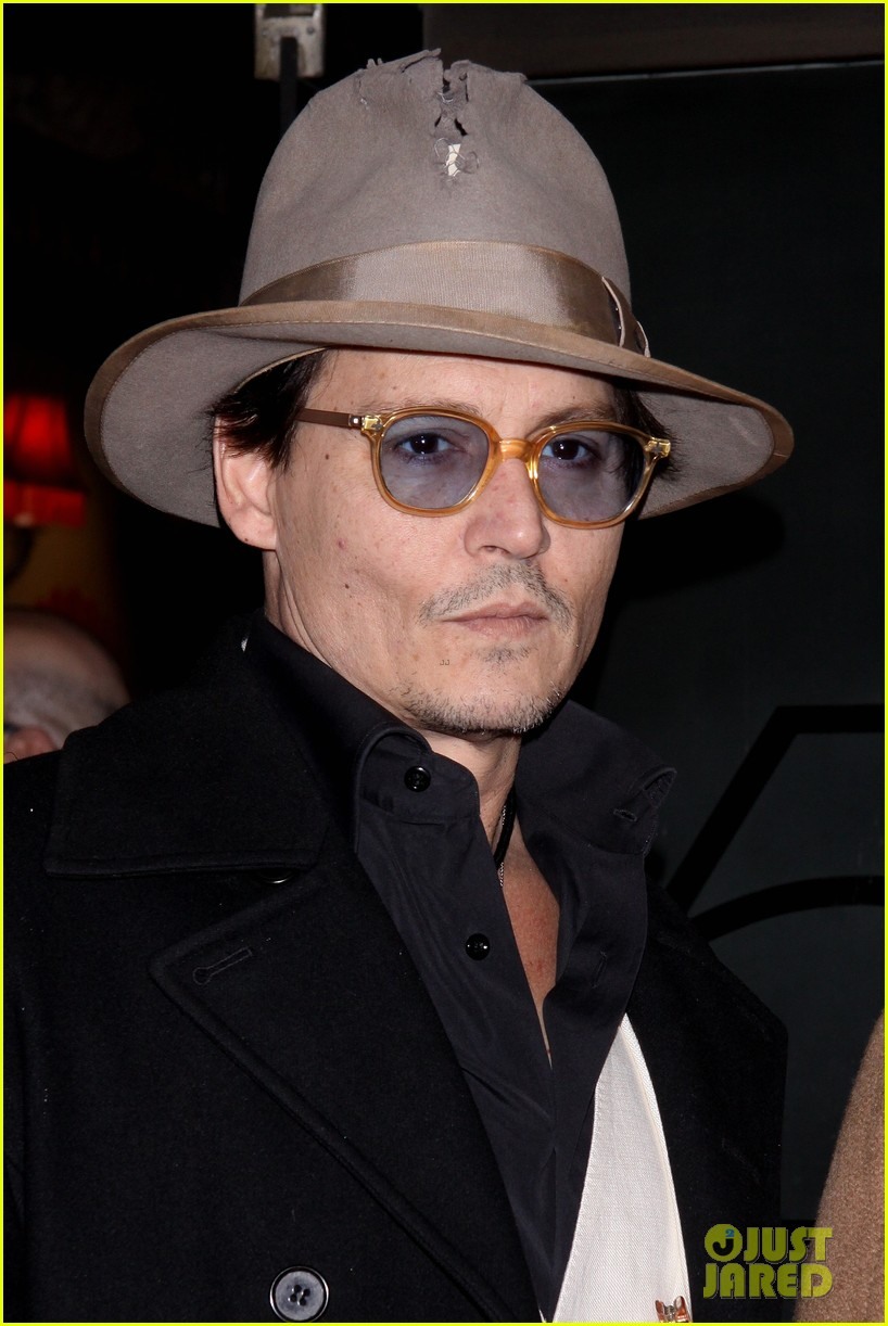johnny depp amber heard hold hands at cabaret opening 203098577