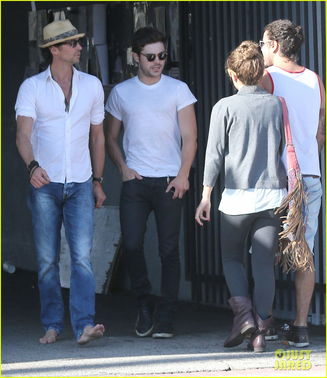 zac efron toned arms shopping guitars 153084145