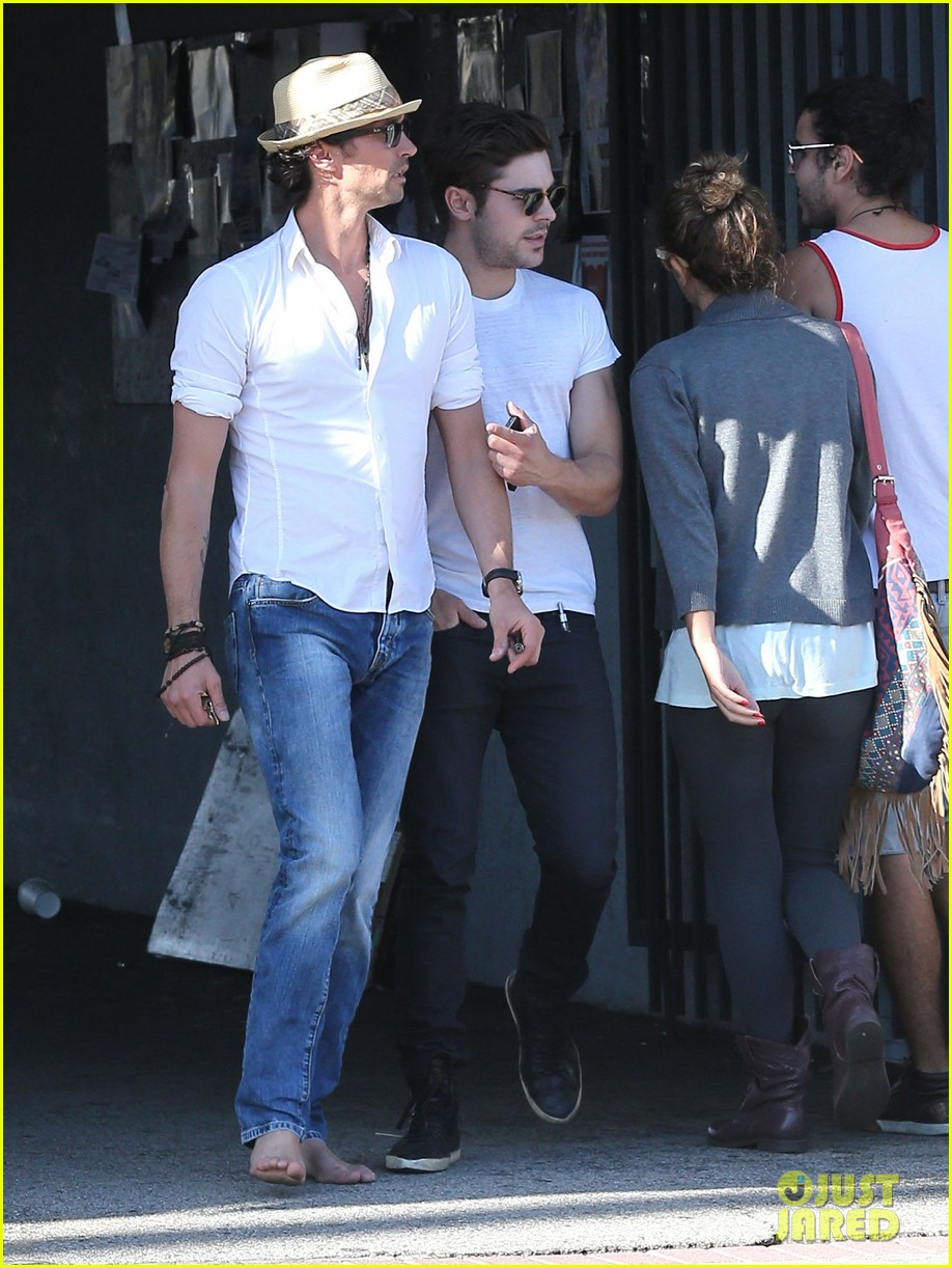 zac efron toned arms shopping guitars 173084147