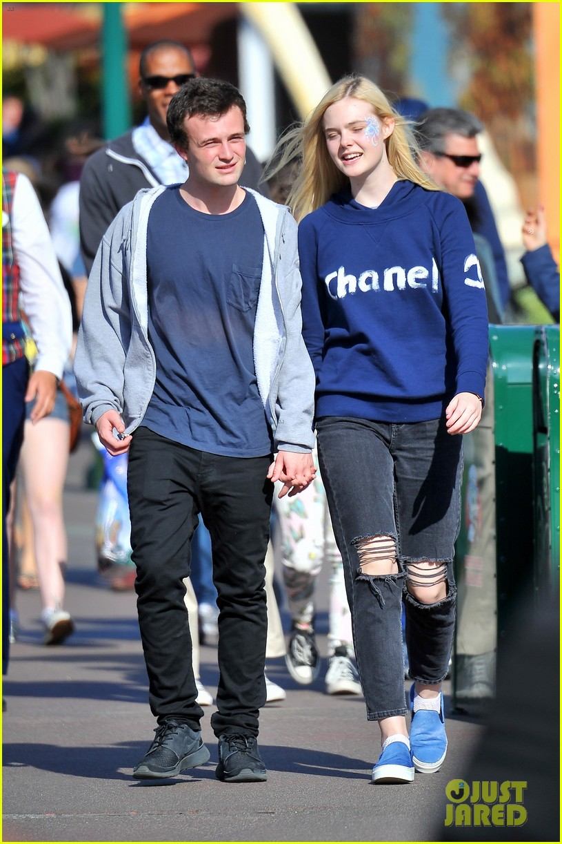 elle fanning boyfriend hold hands at disneyland 033089946