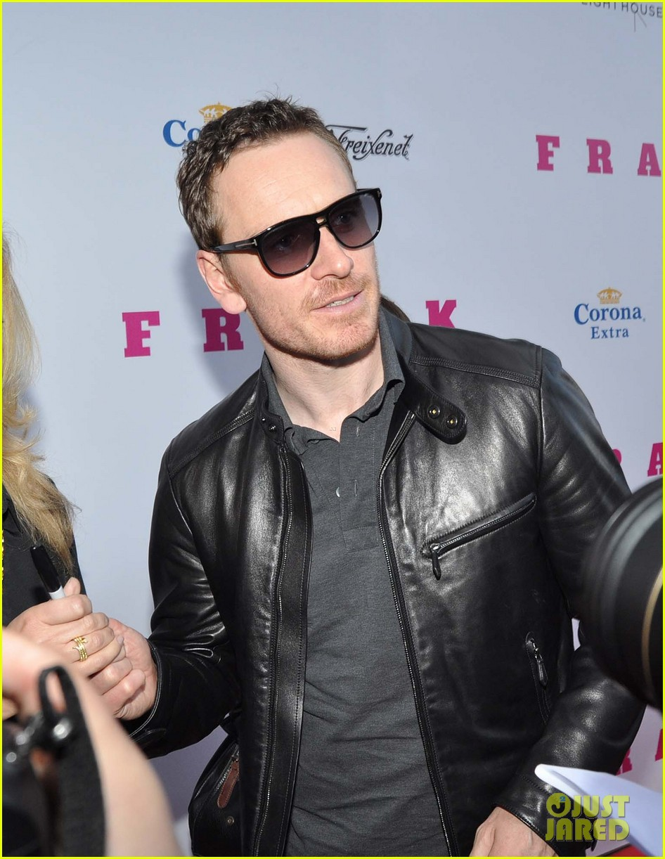 michael fassbender works the red carpet in a leather jacket 053098311