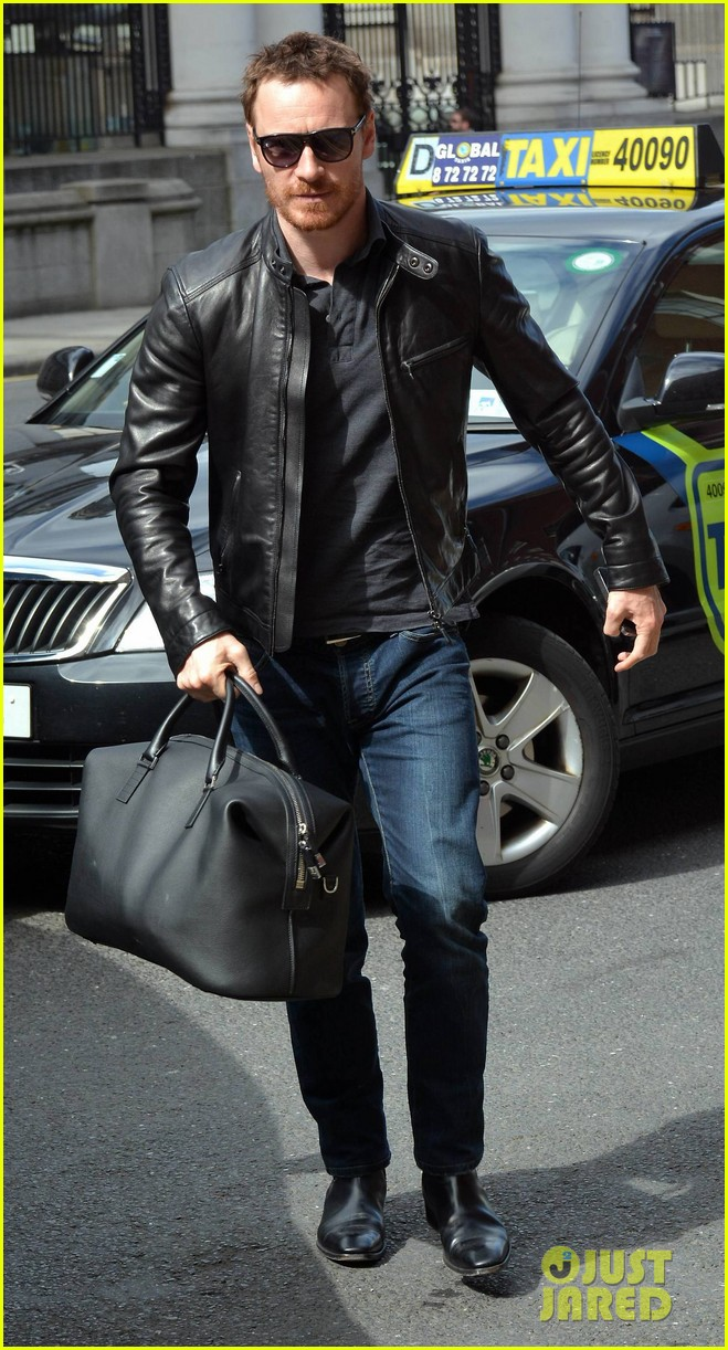 michael fassbender works the red carpet in a leather jacket 063098312