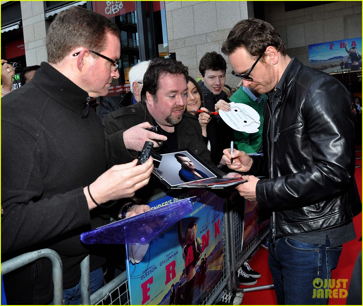 michael fassbender works the red carpet in a leather jacket 083098314