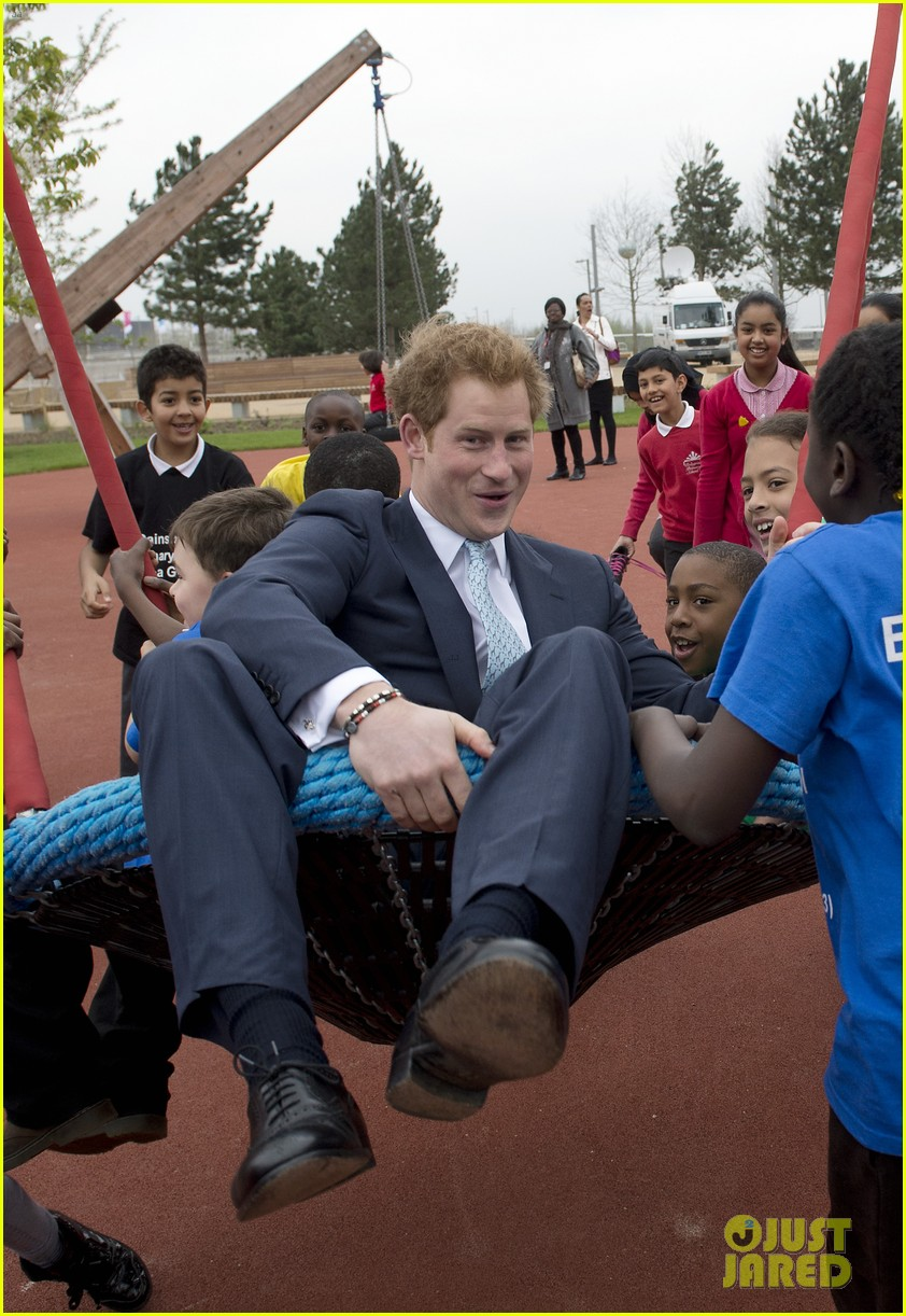 prince harry playing with kids at a playground 013084690