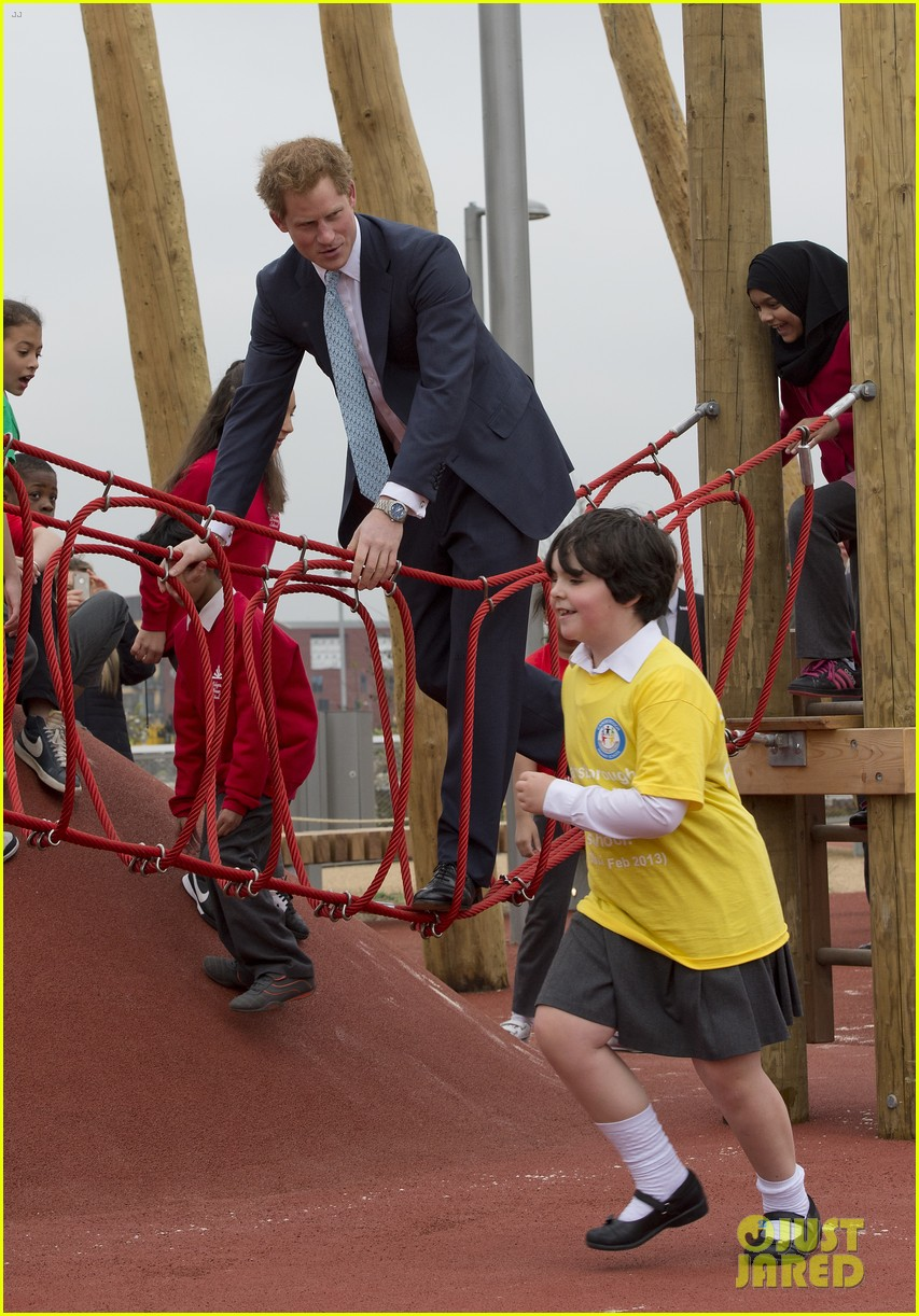 prince harry playing with kids at a playground 043084693