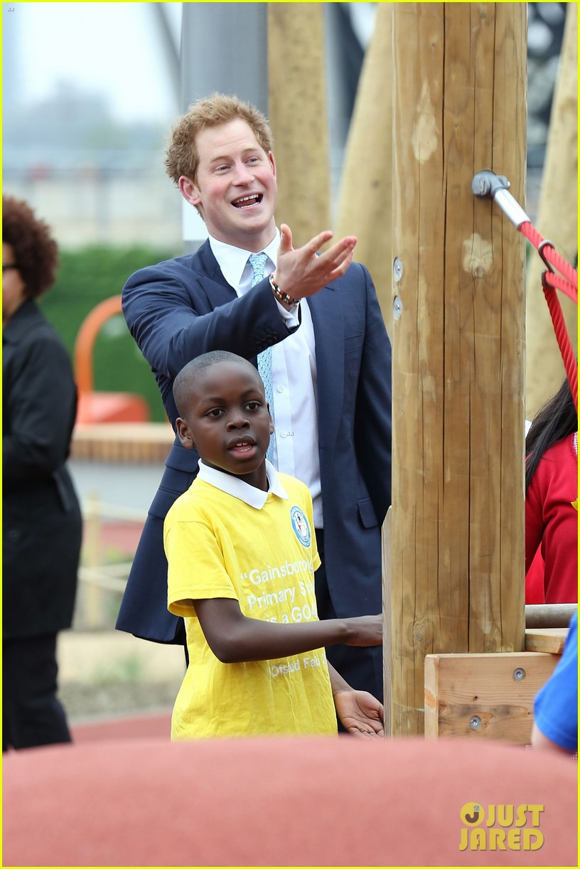 prince harry playing with kids at a playground 053084694