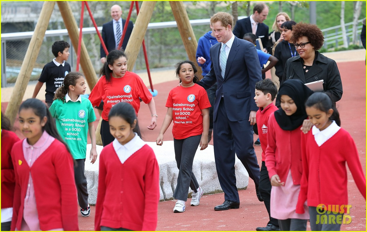 prince harry playing with kids at a playground 063084695