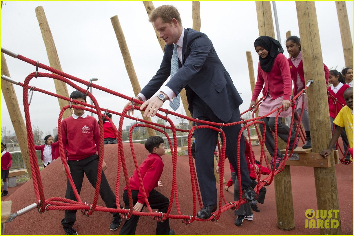 prince harry playing with kids at a playground 093084698
