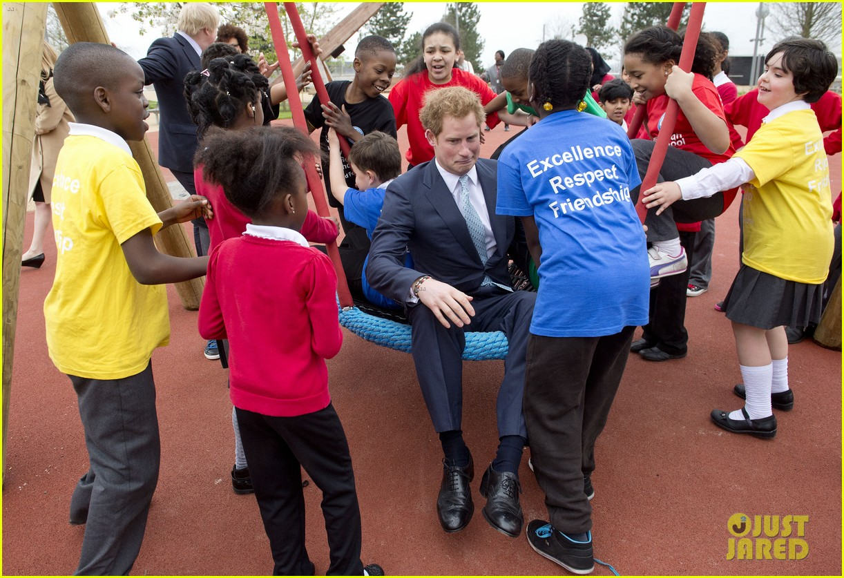 prince harry playing with kids at a playground 103084699